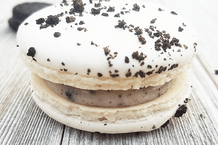 cookies n' cream macarons on table