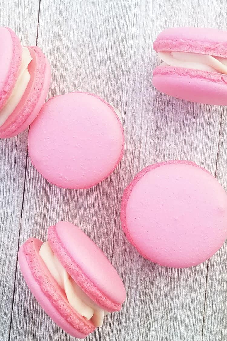 Strawberry Cheesecake Macarons on gray background