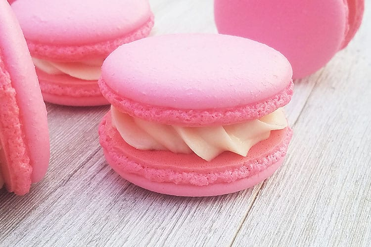 Strawberry Cheesecake Macarons on gray board