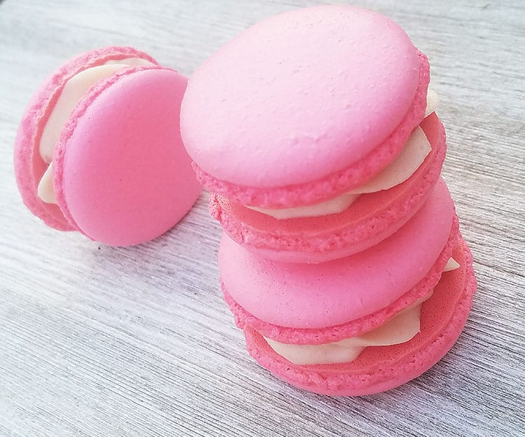 Strawberry Cheesecake Macarons on gray background