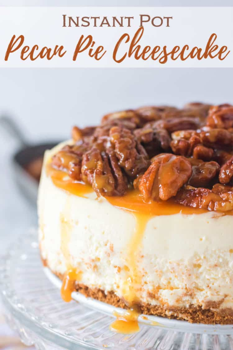 instant pot pecan pie cheesecake on a cake stand with dripping caramel