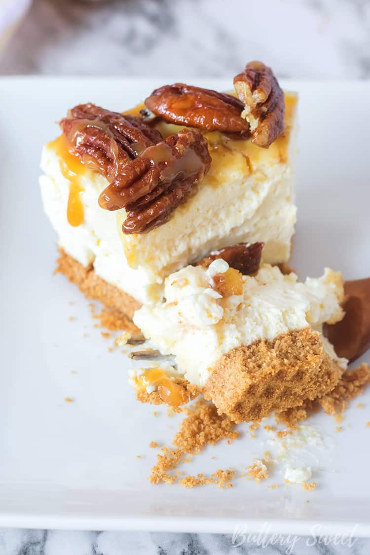 Slice of Instant Pot Pecan Pie Cheesecake with bite taken out
