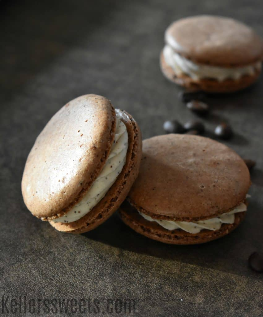 Chocolate Espresson Macarons on gray background with coffee beans