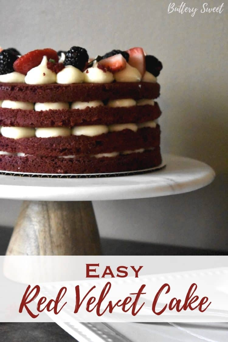 Easy Red Velvet Cake on cake stand with layers of frosting and berries and pinterest text