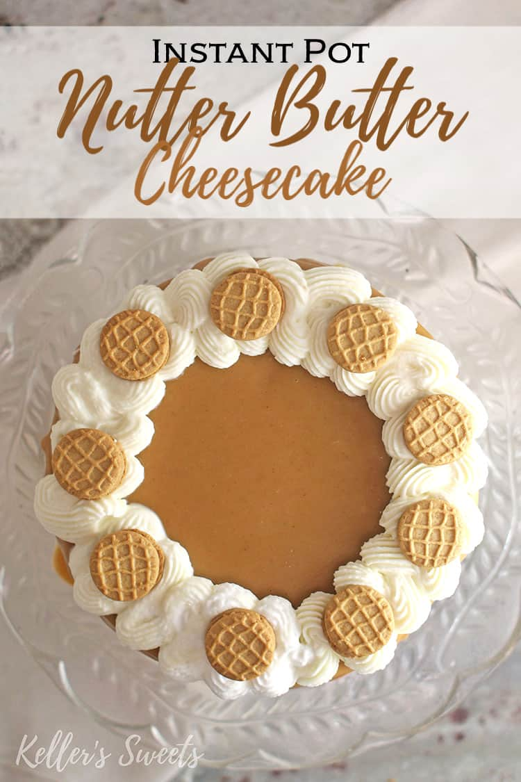 whole Instant Pot Nutter Butter Cheesecake on clear cake stand from above