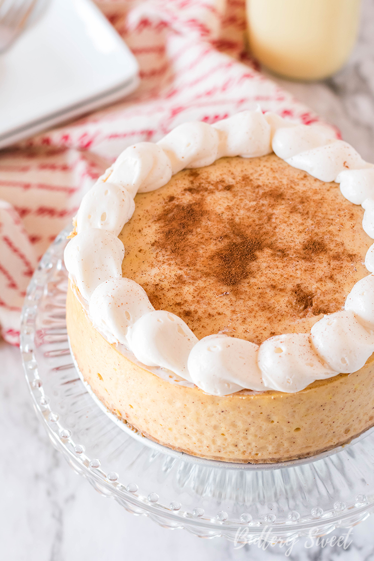 Instant Pot Eggnog Cheesecake dusted with cinnamon and cream cheese frosting