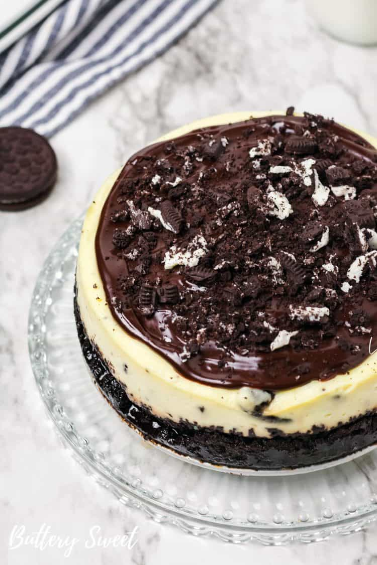 slice of Instant Pot OREO Cheesecake with Ganache and crushed cookies
